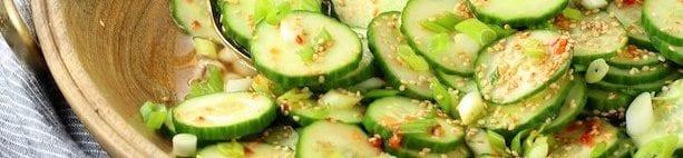 cucumber salad in wood bowl