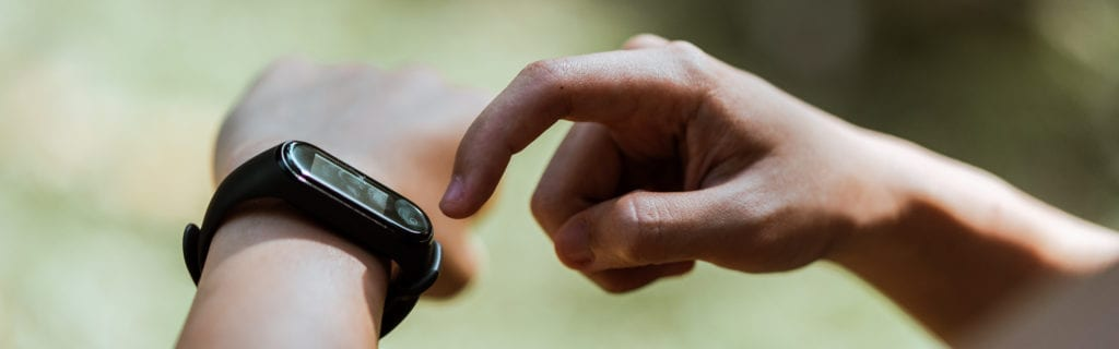 person checking smart watch