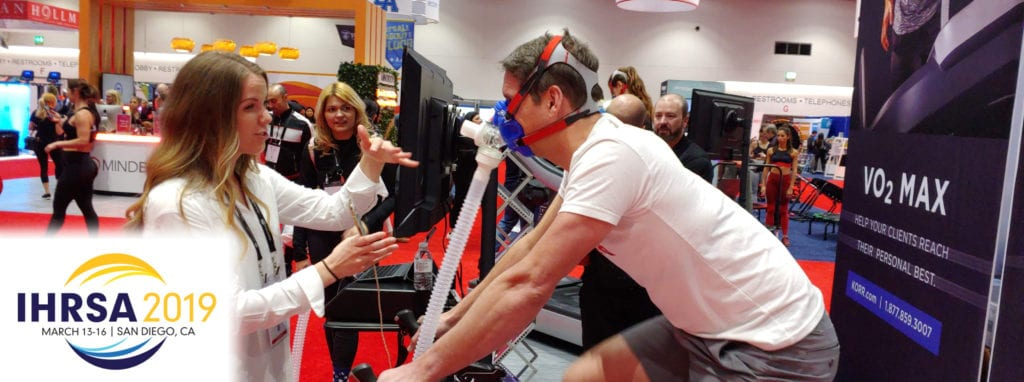 man testing vo2 mask at a conference