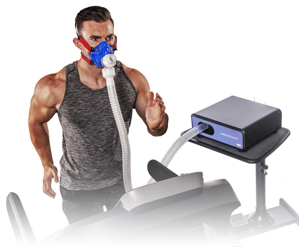 man running on treadmill wearing vo2 mask