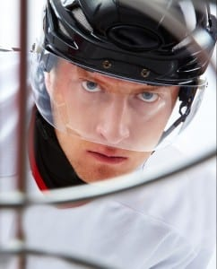 Portrait of hockey player looking at adversary before making goal