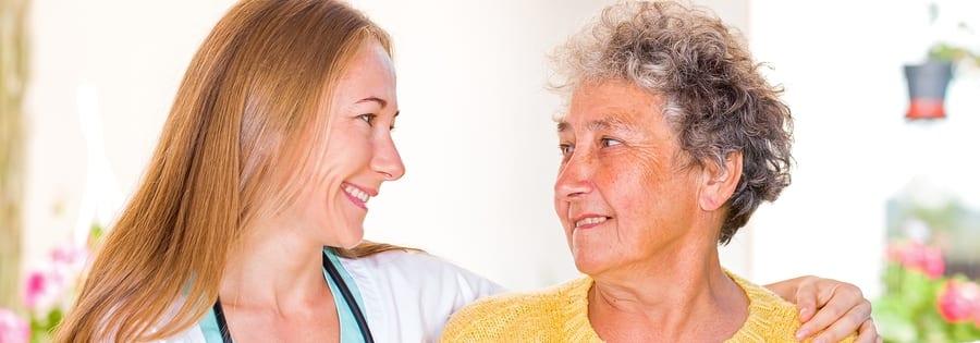 woman caretaker with elderly woman