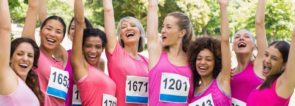 women in pink cheering