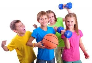 Group of sporty children friends with dumbells and ball isolated over white . Childhood happiness active sports lifestyle concept