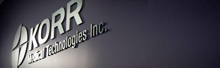 korr medical technologies inc. sign on purple wall