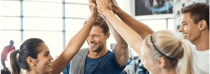 group at the gym giving a group high five