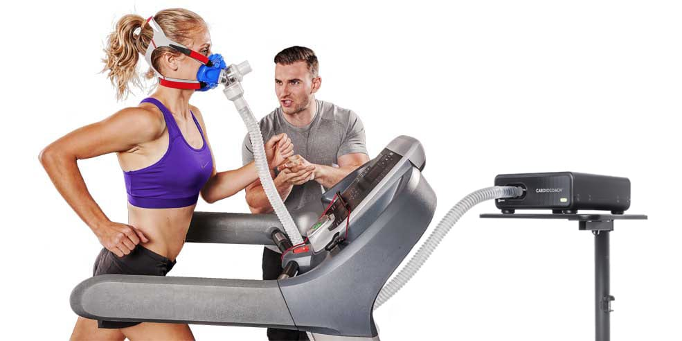 woman running on treadmill wearing vo2 mask with person next to her